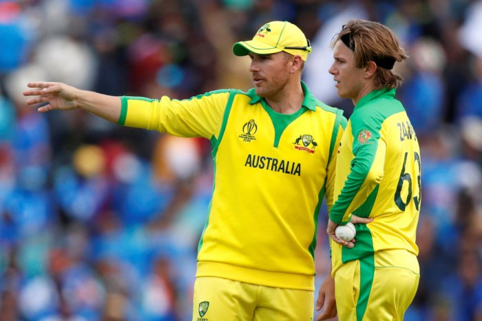 Australia skipper Aaron Finch (left) said leg-spinner Adam Zampa uses hand warmer every game he plays. Reuters