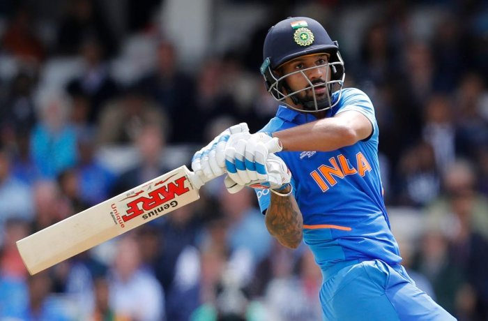 India's Shikhar Dhawan pulls one to the fence en route his century against Australia in London on Sunday. AFP