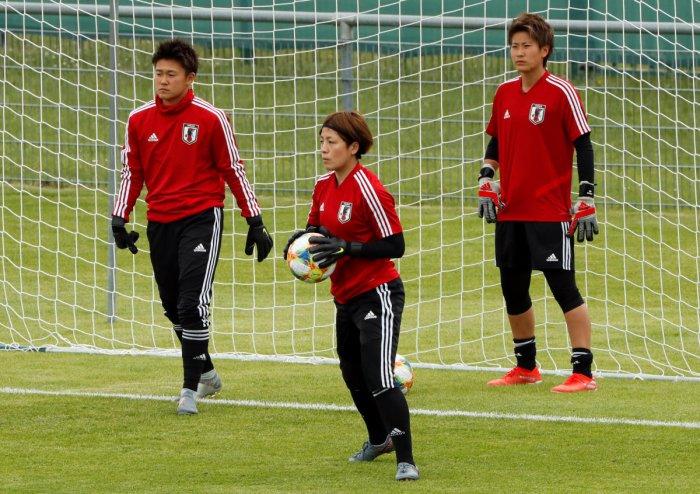 Japan's Sakiko Ikeda, Ayaka Yamashita and Chika Hirao during training. REUTERS