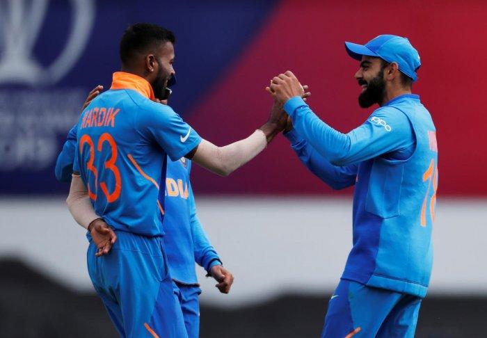 Virat Kohli and Hardik Pandya celebrate the wicket of Australia's Aaron Finch. Reuters