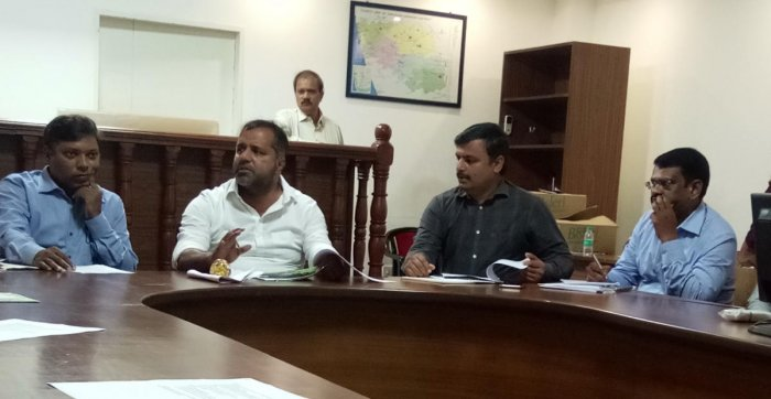 District In-charge Minister U T Khader speaks at a meeting on monsoon preparedness at the deputy commissioner's office in Mangaluru on Monday.