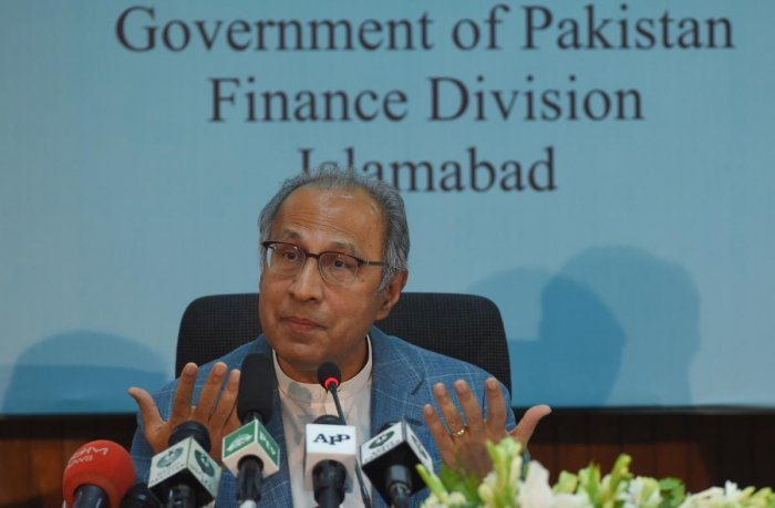 Advisor to Prime Minister Imran Khan on Finance, Revenue and Economic Affairs Abdul Hafeez Shaikh gestures during a pre-budget press conference in Islamabad. (AFP Photo)