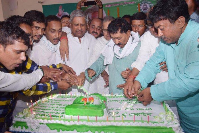 Patna: Rashtriya Janata Dal (RJD) workers celebrate the birthday of RJD chief Lalu Prasad Yadav, in Patna, Tuesday, June 11, 2019. (PTI Photo)