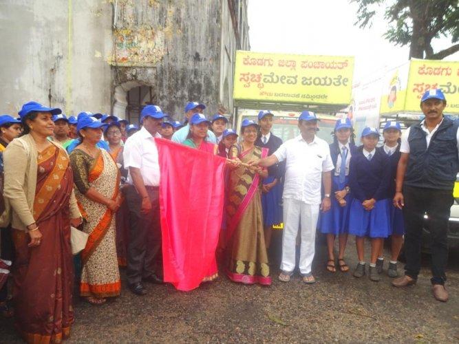 MLA Appachu Ranjan flags off the 'Swacchameva Jayathe' campaign, on the premises of Old Fort Hall in Madikeri on Tuesday. Zilla Panchayat Vice President Lokeshwari Gopal and Chief Executive Officer K Lakshmi Priya look on.