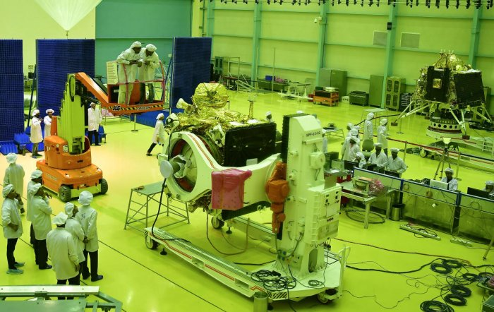 ISRO personnel busy in final stage checking of Chandrayan-2 orbiter and lander at ISRO Satelite Integration and testing establishment in Bengaluru. DH photo by Krishnakumar P S