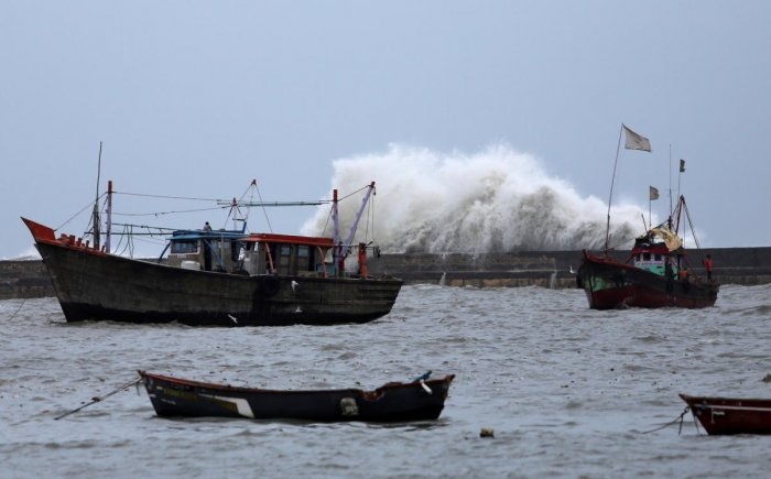 Waves crash against the jetty at a fishing harbour ahead of the expected landfall of Cyclone Vayu at Veraval. Reuters photo