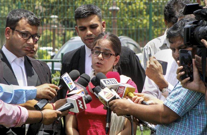 Jagisha Arora, wife of journalist Prashant Kanojia, speaks to the media outside the Supreme Court, in New Delhi. PTI photo