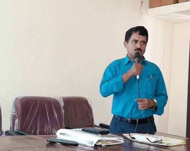 District Surveillance Officer Dr Vasudeva speaks at a meeting in Udupi.