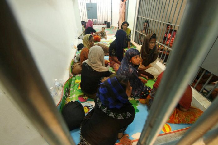 Rohingya people are seen detained in a police station after a fishing boat carrying more than sixty Rohingya refugees was found beached at Rawi island, part of Tarutao national park in the province of Satun, Thailand. (Reuters Photo)
