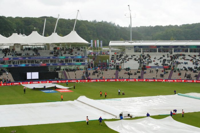 General view of the covers over the pitch during a rain delay. Reuters