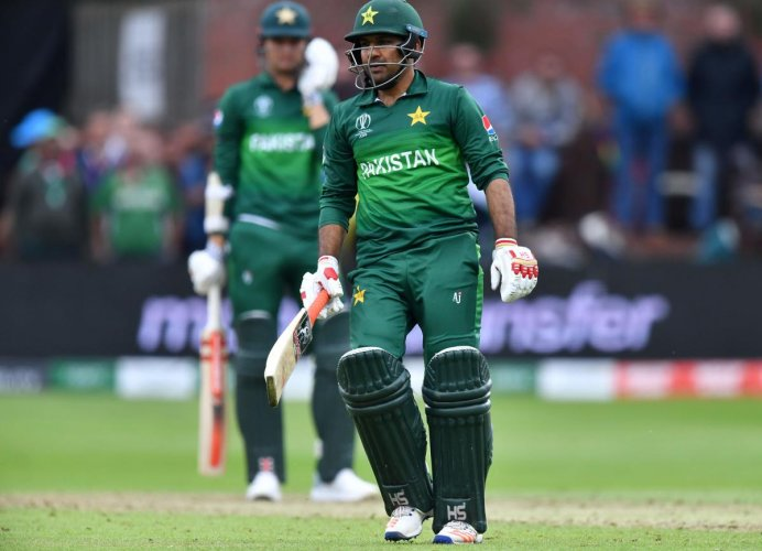 Pakistan's captain Sarfaraz Ahmed walks off the field after defeat in the 2019 Cricket World Cup group stage match between Australia and Pakistan at The County Ground in Taunton. AFP