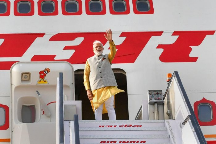 Prime Minister Narendra Modi waves as he emplanes for Bishkek, Kyrgyz Republic to attend a meeting of the Council of Heads of State of the Shanghai Cooperation Organization. PTI photo