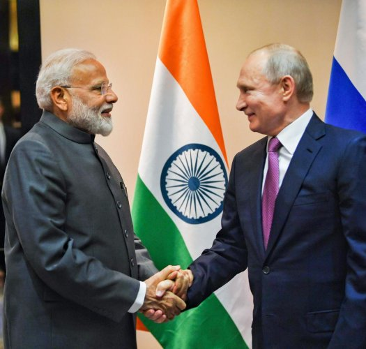 Narendra Modi shakes hands with Russian President Vladimir Putin during a meeting on the sidelines of the Shanghai Cooperation Organisation (SCO) Summit in Bishkek. (PTI Photo)