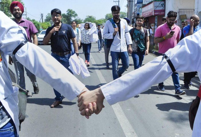 Doctors wore black bands to express solidarity with their protesting colleagues in West Bengal. (Photo PTI)