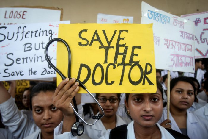 A doctor holds a placard at a government hospital during a strike demanding security after the recent assaults on doctors by the patients' relatives. (Reuters Photo)