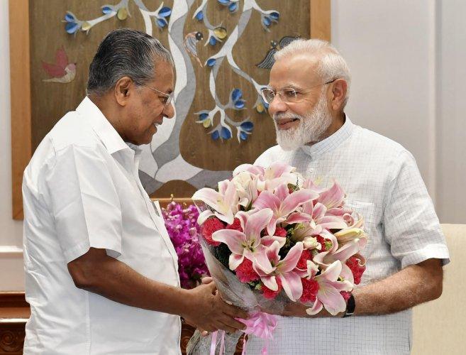 Prime Minister Narendra Modi with Chief Minister of Kerala Pinarayi Vijayan during a meeting, New Delhi, Saturday, June 15, 2019. (PTI Photo)