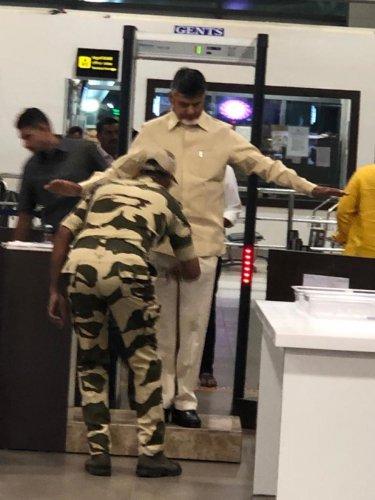 Mobile photo of Nara Chandrababu Nadu undergoing frisking at the Gannavaram Airport on Friday.