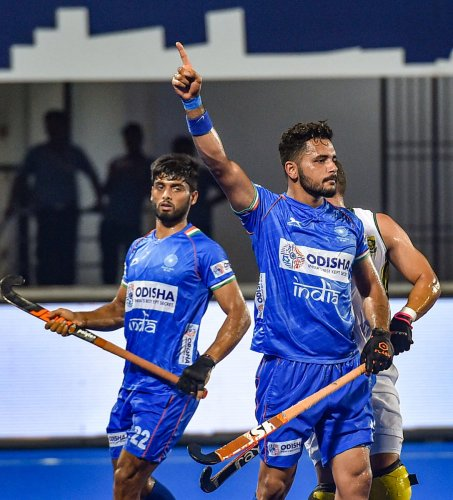 CLINICAL: India's Harmanpreet Singh (right) celebrates after scoring a goal against South Africa during the title clash of the FIH Series Finals in Bhubaneswar on Saturday. PTI