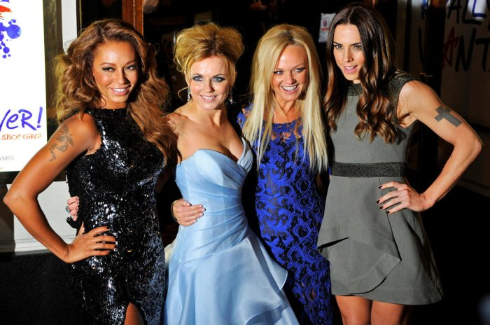 """Spice Girl members Melanie Brown (L-R), Geri Halliwell, Emma Bunton and Melanie Chisholm arrive for the premiere of the musical """"Viva Forever!"""" (Photo by REUTERS)"""
