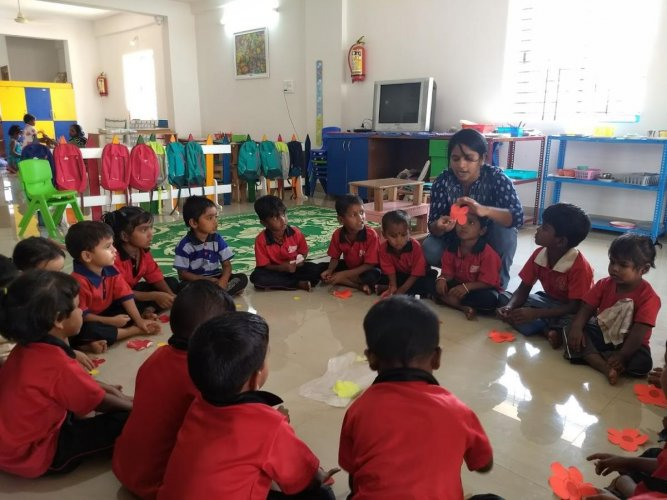 Children of migrant construction workers engaged in an activity at Diya Ghar, Bengaluru; parents meet at Sampark in Bengaluru; math classes being conducted for older children by Outreach at their centre in Bengaluru.
