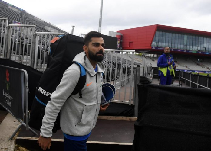 Virat Kohli arrives for a training session at Old Trafford Cricket Stadium in Manchester on June 15, 2019, ahead of the 2019 World Cup match between India and Pakistan. AFP