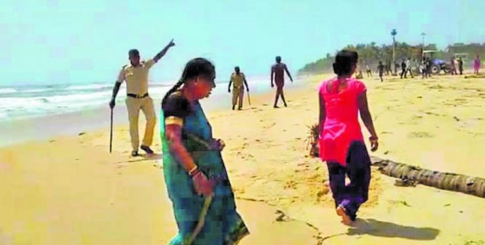 A video grab of a home guard personnel warning tourists from entering beach at Malpe on Sunday.
