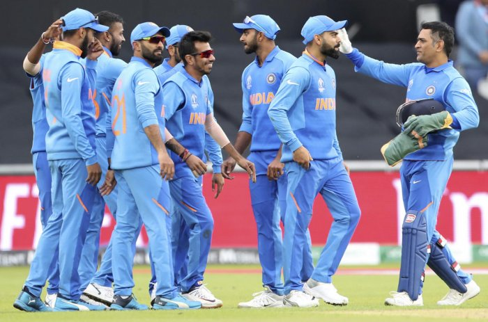 Indian players celebrate the dismissal of Pakistan's Shoaib Malik during the Cricket World Cup match between India and Pakistan at Old Trafford in Manchester, England, Sunday, June 16, 2019. AP/PTI Photo