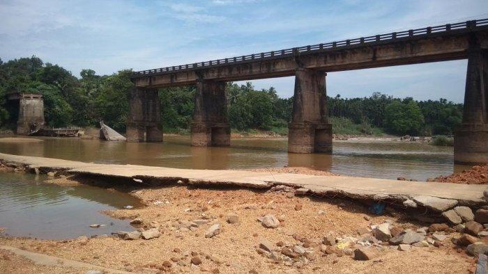 A view of the Moolarapattana bridge across River Phalguni that has collapsed.