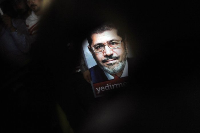 A poster of Egypt's President Mohamed Morsi is seen during a pro-Morsi demonstration in Istanbul. (AFP File Photo)
