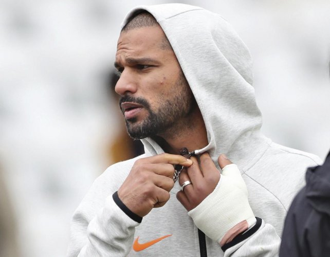 Shikhar Dhawan with his injured thumb. Credit: AP/PTI