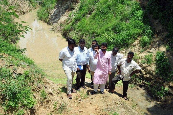 MLA C T Ravi inspecting the canal of Karagada project in Chikkamagaluru.