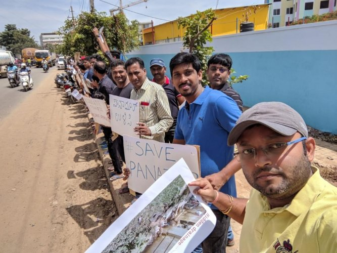Residents of Panathur recently formed a human chain, holding placards and listing their civic problems.