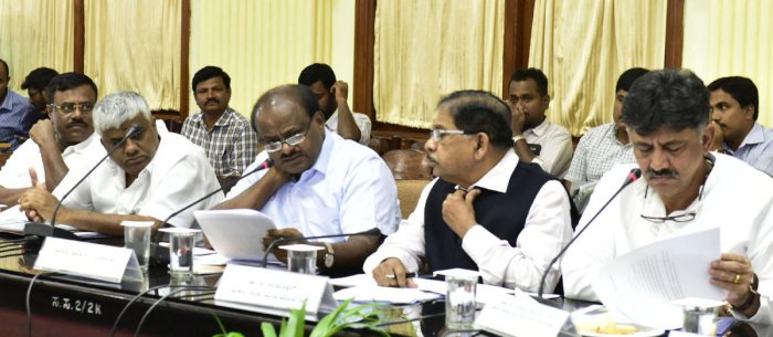 Chief minister heald a meeting on Distribution for the Cauvery water for the village with H D Reevana, Dr. G Parameswara and D K Shivakumar at Vidhanasoudha conference hall in Bengaluru. (DH Photo)