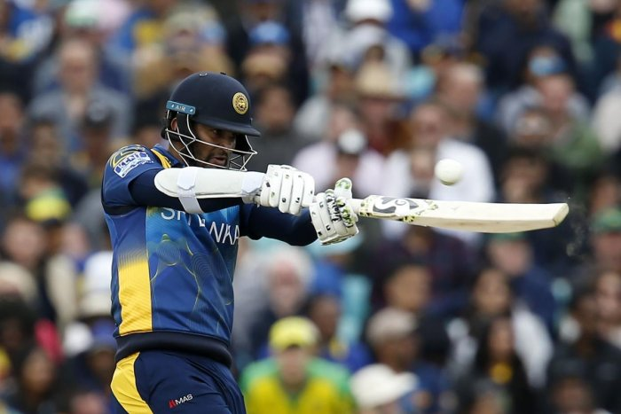 Sri Lanka's captain Dimuth Karunaratne plays a shot during the 2019 Cricket World Cup group stage match between Sri Lanka and Australia at The Oval in London. (AFP Photo)