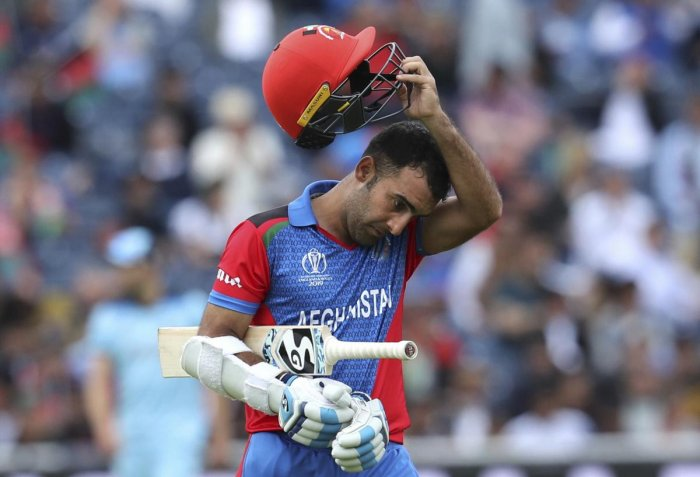 Manchester: Afghanistan's Hashmatullah Shahidi leaves the field after being dismissed during the Cricket World Cup match between England and Afghanistan at Old Trafford in Manchester. (PTI Photo)