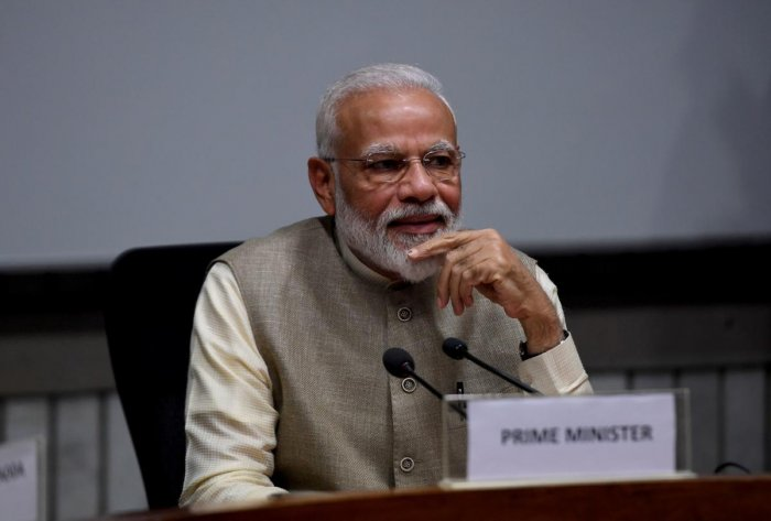 "Prime Minister Narendra Modi on Thursday joined a host of cricketers to offer his sympathy to injured India opener Shikhar Dhawan, saying ""the pitch will miss you."" (AFP Photo)"