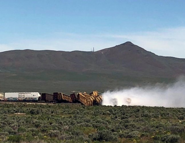 Smoke rises from overturned train wagons after an accident near Wells, Nevada, U.S., June 19, 2019, 2019 in this picture obtained from social media. Twitter/Michael Lyday/via REUTERS