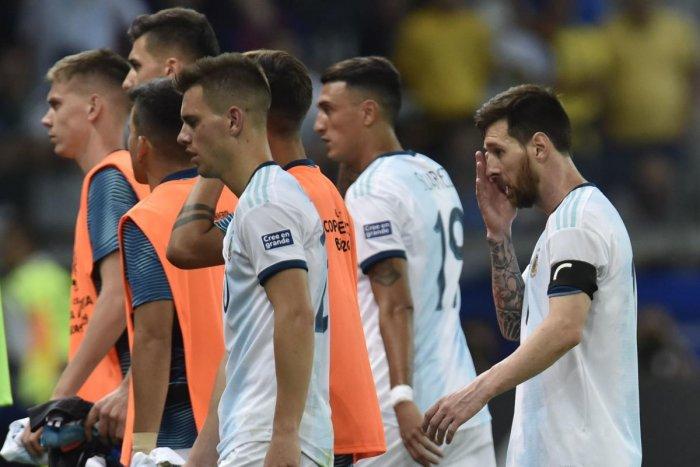 Argentina's Lionel Messi (R) is pictured after tying 1-1 with Paraguay in their Copa America football tournament group match at the Mineirao Stadium in Belo Horizonte, Brazil, on June 19, 2019. (AFP)