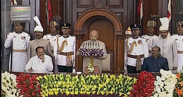 President Ram Nath Kovind addresses a joint session of Parliament in the presence of Vice President Venkaiah Naidu and Lok Sabha Speaker Om Birla, in New Delhi on Thursday. (PTI Photo)