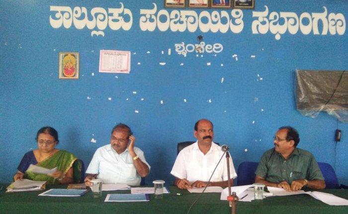 Malnad Development Corporation Chairman T D Rajegowda chairs the Taluk Task Force Committee meeting at the Sringeri Taluk Panchayat Hall.