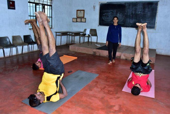 Champion: Nazia instructing students at her yoga class in Nitte; Nazia performing Chakrasana.dh photos/Govindraj javali