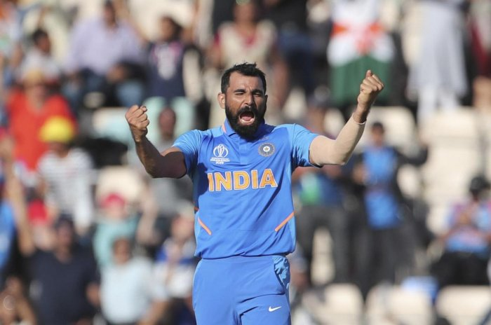 Mohammad Nabi nearly pulled it off for Afghanistan, but Mohammed Shami took a hat-trick to seal the game in the last over as the underdogs were bowled out for 213. (AP/PTI Photo)