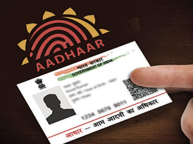 A bill to allow voluntary use of Aadhaar as an identity proof for opening bank accounts and procuring mobile phone connections was introduced in the Lok Sabha. (DH Photo)