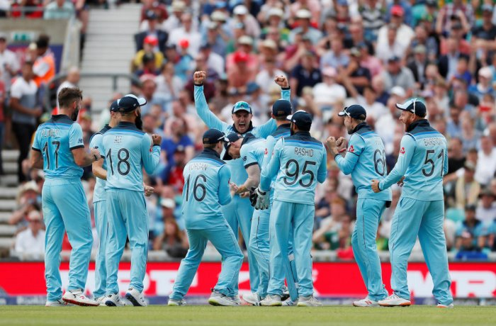 Cricket - ICC Cricket World Cup - England v South Africa - Kia Oval, London, Britain - May 30, 2019 England's Ben Stokes celebrates with Eoin Morgan and team mates after running out South Africa's Dwaine Pretorius Action Images via Reuters/Paul Childs