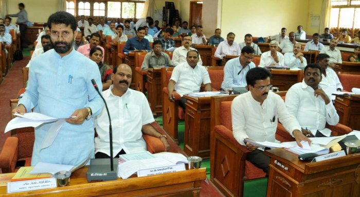 MLA C T Ravi speaks at the quarterly review meeting of the Karnataka Development Programmes in Chikkamagaluru on Monday.