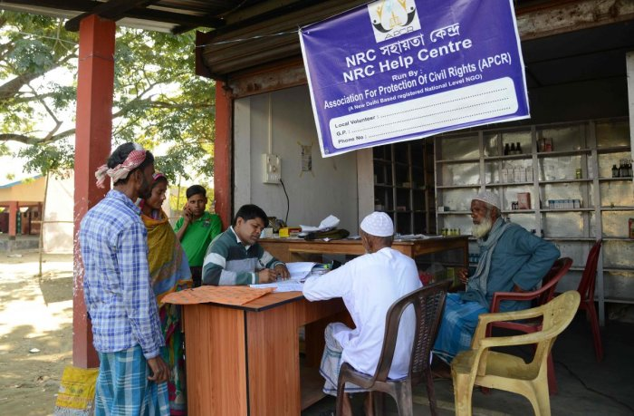 In this photo taken on December 8, 2018, villagers gather to check their documents at a National Register of Citizens (NRC) help centre for people whose names were not featured in the final draft of the NRC at Hatisola village in Kamrup district in India'