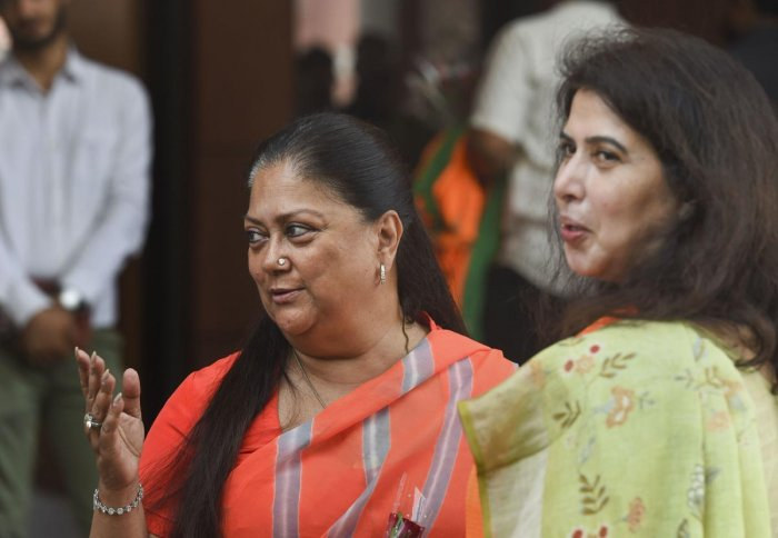 New Delhi: BJP leaders Vasundhara Raje and Saroj Pandey arrive for a meeting of party's national office bearers and state presidents presided by party President Amit Shah. (PTI Photo)