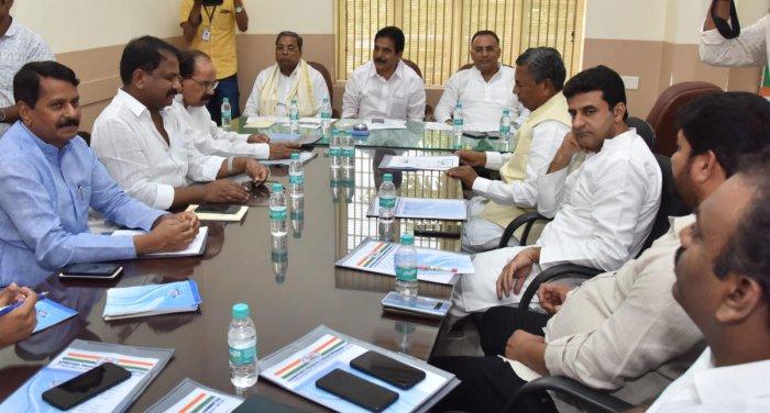 AICC general secretary and Karnataka Incharge K C Venugopal chairs a meeting at the KPCC office in Bengaluru on Wednesday. CLP leader Siddaramaiah, KPCC president Dinesh Gundurao, defeated Congress candidates B N Chandrappa, Dhruvanarayan, M Veerappa Moil