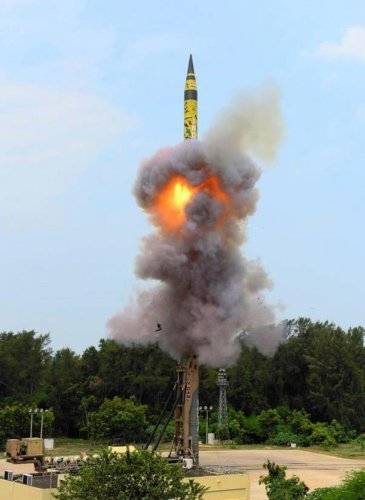 The long-range nuclear-capable ballistic missile Agni-5 lifts off from the mobile launch pad-4 of the Integrated Test Range at the APJ Abdul Kalam Island in Bay of Bengal on Sunday. PTI