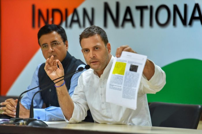 Congress President Rahul Gandhi speaks as AICC chief spokesperson Randeep Singh Surjewala looks on, during a press conference at AICC HQ, in New Delhi, Thursday, Oct 11, 2018. (PTI Photo)